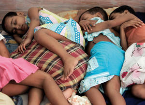 Children, of a sex worker sleep, inside a room, at Soma Home in the eastern Indian city of Kolkata