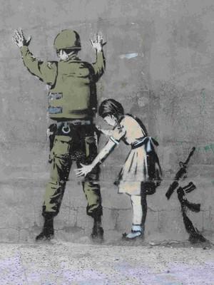 Uno dei tanti bellissimi murales che si trovano lungo il muro della vergogna, fatto edificare dal governo israeliano
