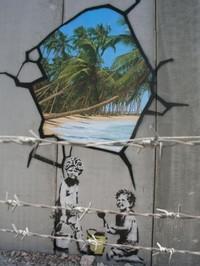 un murales di bansky sul muro tra israele e palestina