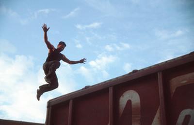 Migrante salta da un vagone, stato del Chiapas, Messico - Copyright Hauke Lorenz