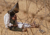Jean-Marc Bouju France, The Associated Press Iraqi man comforts his son at a regroupment center for POWs, Najaf, Iraq, 31 March