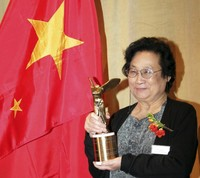 Chinese pharmacologist Tu Youyou poses with her trophy after winning the Lasker Award, a prestigious U.S. medical prize, in New York in September 2011.