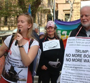 Sit-in, U.S. Embassy in Rome, Saturday, April 14th, 11am N.B. At 3 am on April 14th, Trump ordered a surprise missile attack on Syria. Thus the sit-in, originally called to protest U.S. military spending, became a protest against Trump's illegal military action as well.
