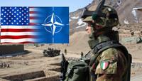 Sul palcoscenico della NATO il narcisismo stizzoso di Trump rianima una l'Alleanza moribonda.                                Il complesso militare-industriale ringrazia, l'Europa divisa si inchina e l'Italia applaude