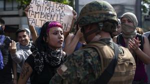 Una scena di guerriglia urbana in Cile