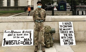 Ahmed Al-Babati protesting opposite Downing Street