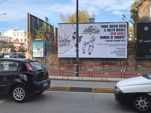 Il grande manifesto affisso in città