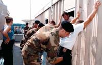 Immigrati clandestini a Otranto in attesa di trasferimento nei centri di accoglienza